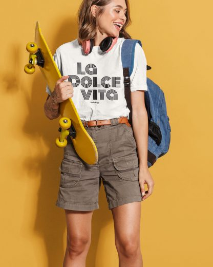 girl with a skateboard in a vintage white la dolce vita t-shirt