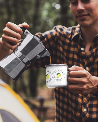 man pouring coffe into la dolce vita enamel mug