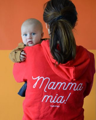 woman with child in red mamma mia zipper hoodie