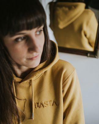 woman wearing Basta hoodie in ochre