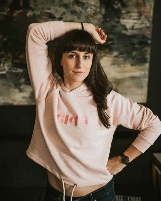 woman wearing pink ciao hoodie