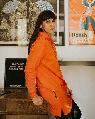 woman wearing espresso hoodie in tangerine