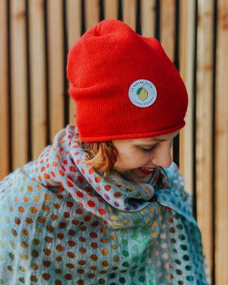 woman wearing red merino beanie