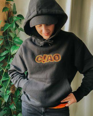 woman wearing black oversize ciao hoodie