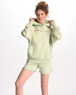 woman wearing light green buongiorno hoodie and green short sweatpants