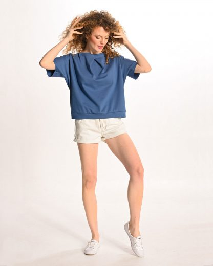 woman wearing blue tshirt with no back